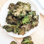 kale chips stacked on a plate
