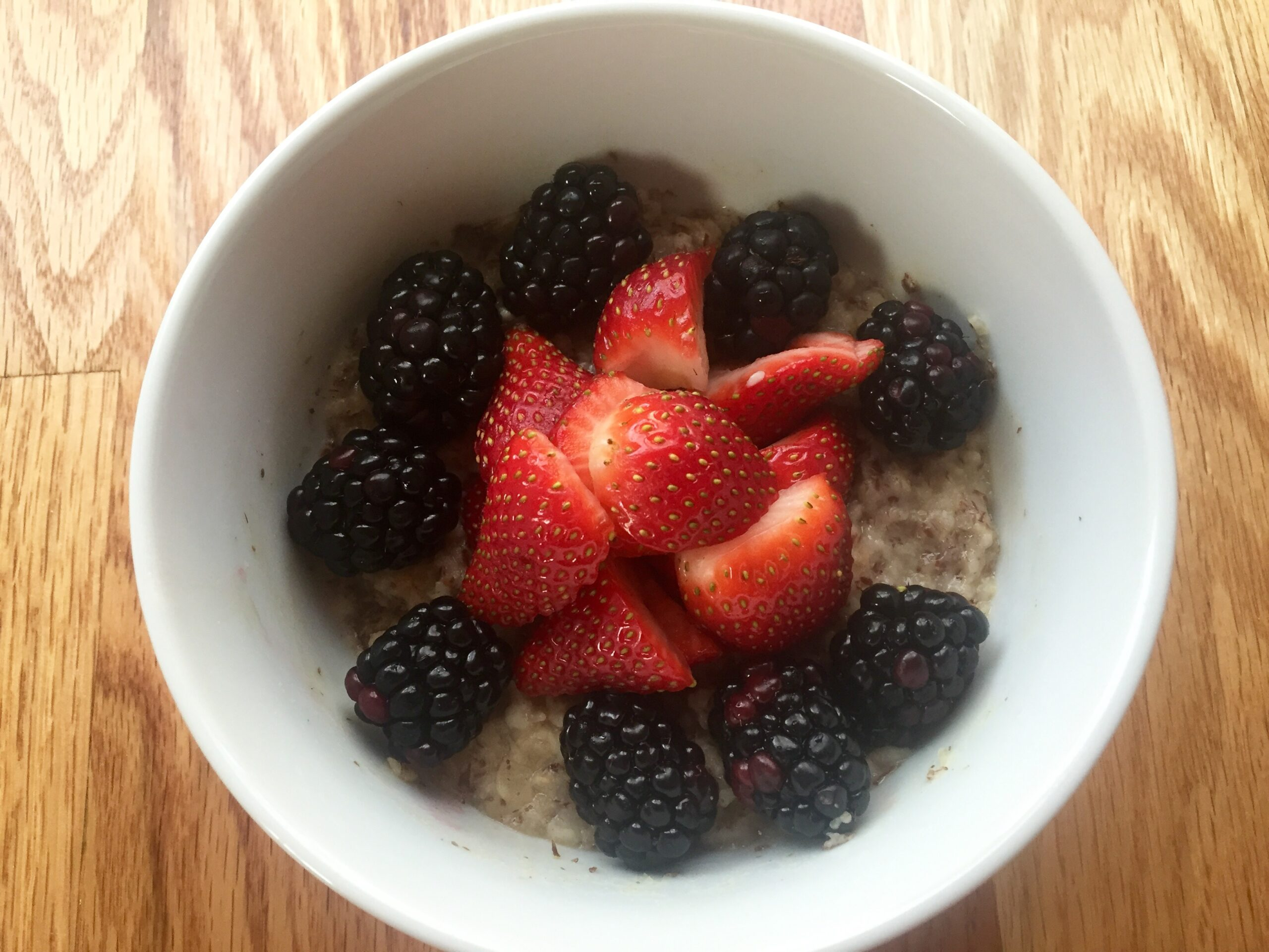 bowl of oatmeal topped with fresh berries
