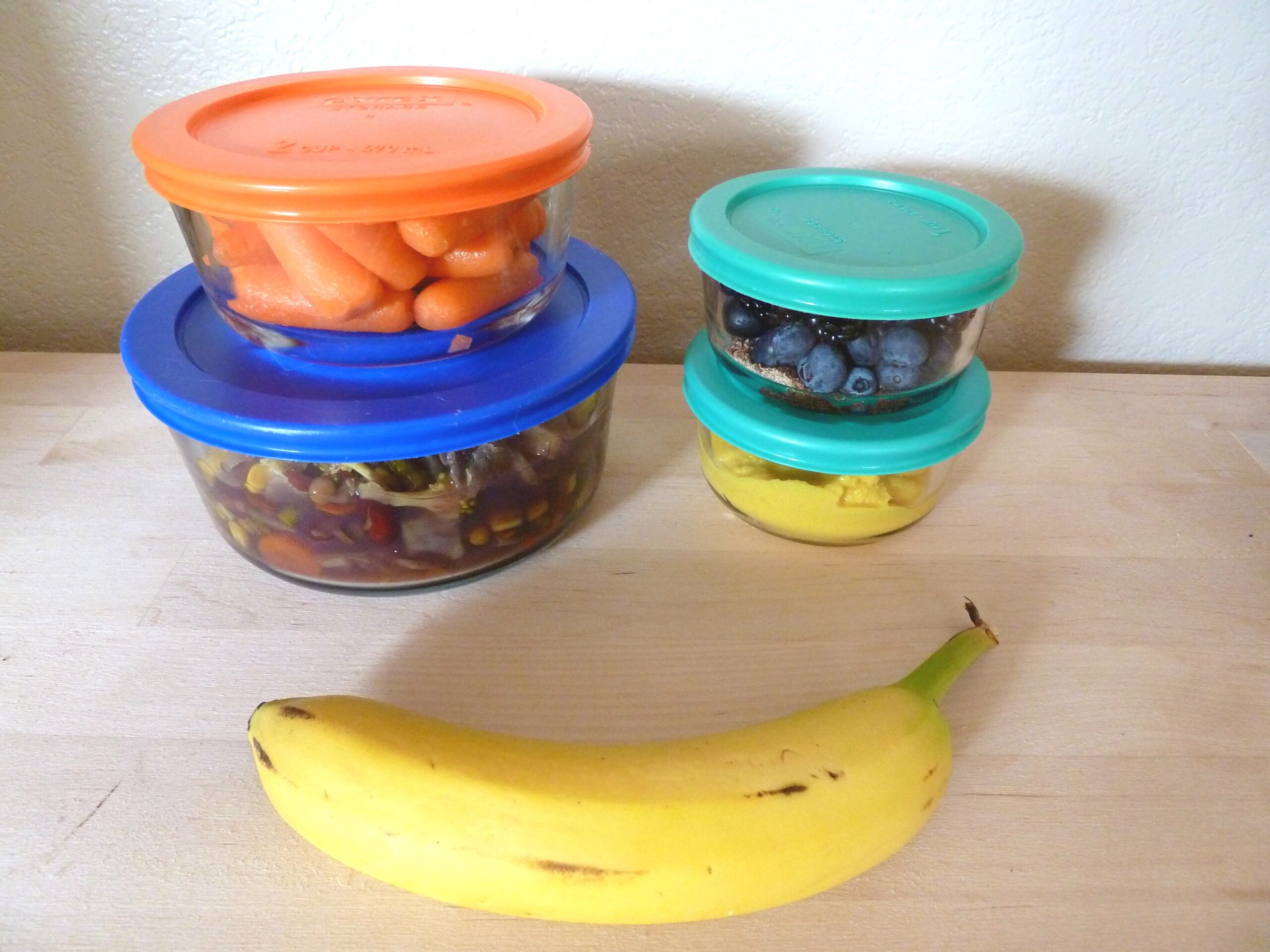 containers of food and a banana