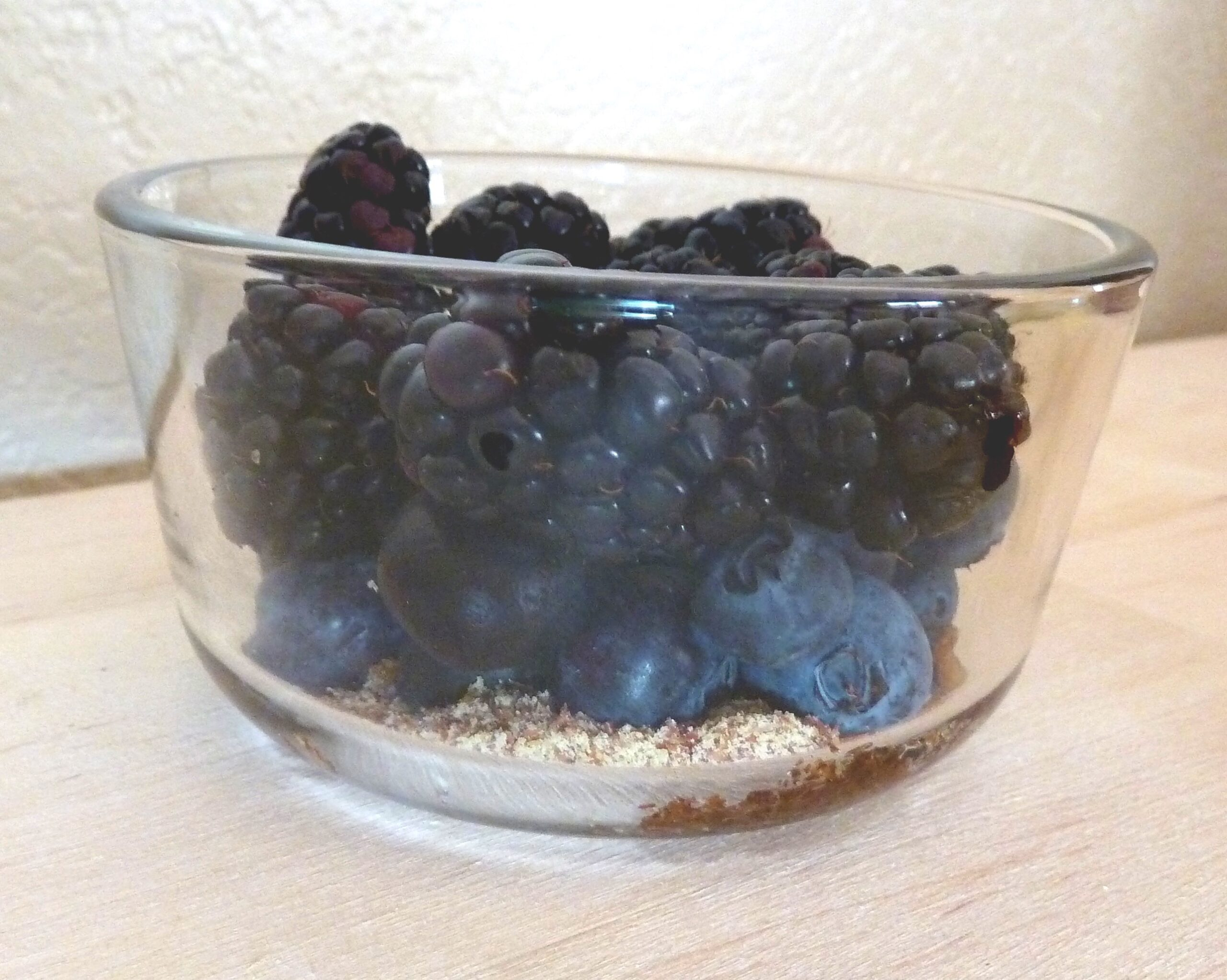 berries and other toppings for oatmeal in a container