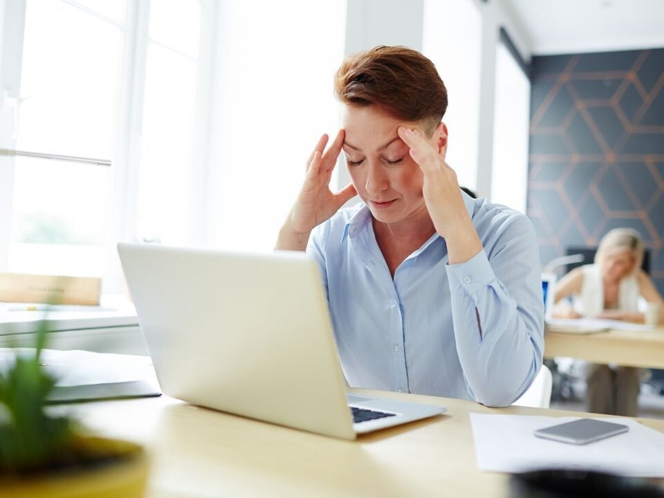 Person at a desk trying to concentrate