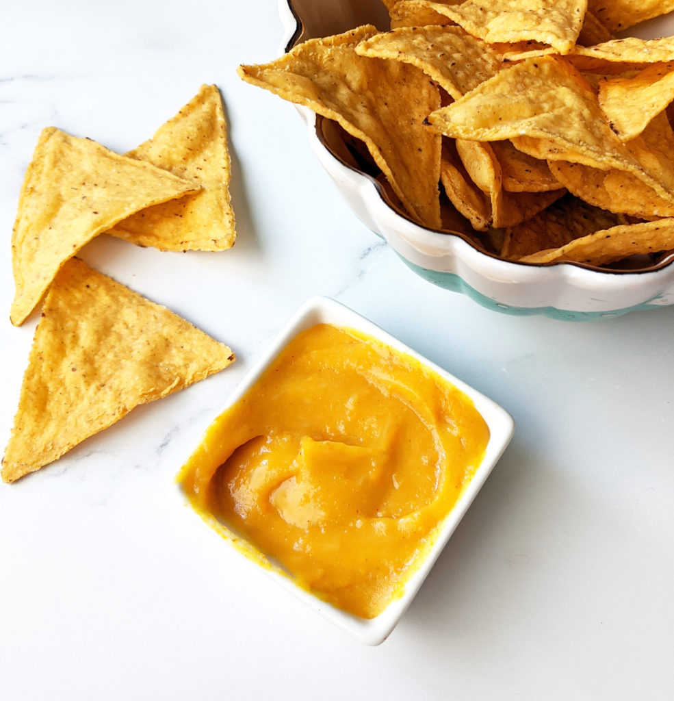 Need a tasty vegan nacho cheese dip? Look no further! This one is nut-free, oil-free, and gluten-free and ACTUALLY tastes like nacho cheese sauce! #vegancheese #vegancheesedip #vegancheesesauce #dairyfree #nondairy #glutenfree #oilfree #nutfree #plantbased #plantbasedcheese #veganrecipe