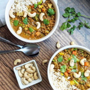 The EASIEST Vegan One-Pot Coconut Lentil Curry! Just 7 main ingredients needed. Makes a ton which is perfect for meal prep! Only requires mostly pantry and freezer friendly ingredients. #vegan #curry #mealprep #vegancurry #plantbased #coconutcurry #lentilcurry #veganrecipe #easyveganmeal #oilfree #glutenfree