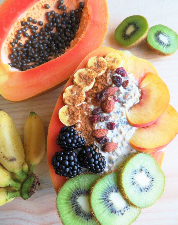 Papaya boats are a delicious and fun way to eat papayas. Fill your papaya up with overnight oats and fresh fruit for a truly tasty and filling breakfast. It's also easy to make and incredibly healthy! This breakfast is a delicious whole food plant based vegan breakfast or snack. #papaya #veganbreakfast #breakfastbowl #healthybreakfast #glutenfree #brunchrecipe #vegan #plantbased
