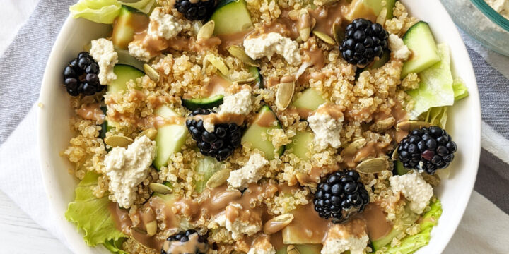 This is the best easy summer salad-- both healthy and delicious, mixed with quinoa, blackberries, a tangy balsamic vinaigrette, topped with pumpkin seeds and a vegan cashew ricotta. #vegansalad #summersalad #easysaladrecipe #cashewricotta #cashewcheese #blackberries