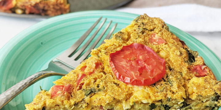 Chickpea flour frittata slice on a plate with a fork