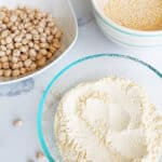 chickpea flour and dried chickpeas in bowls