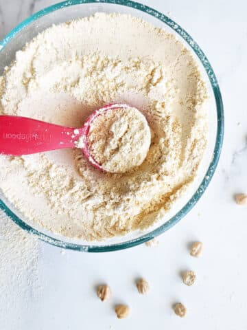 chickpea flour in a bowl with a spoon
