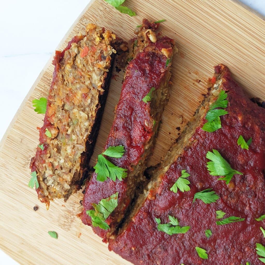 Slices of vegan lentil loaf on a cutting board.