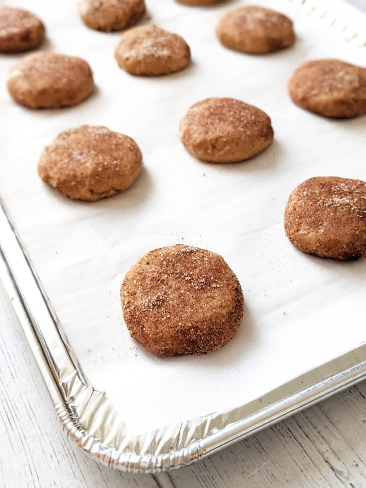 prepped snickerdoodles on a baking sheet ready to be baked