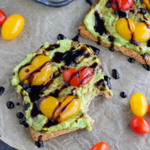 Valentine's day theme avocado toast with heart shaped tomatoes