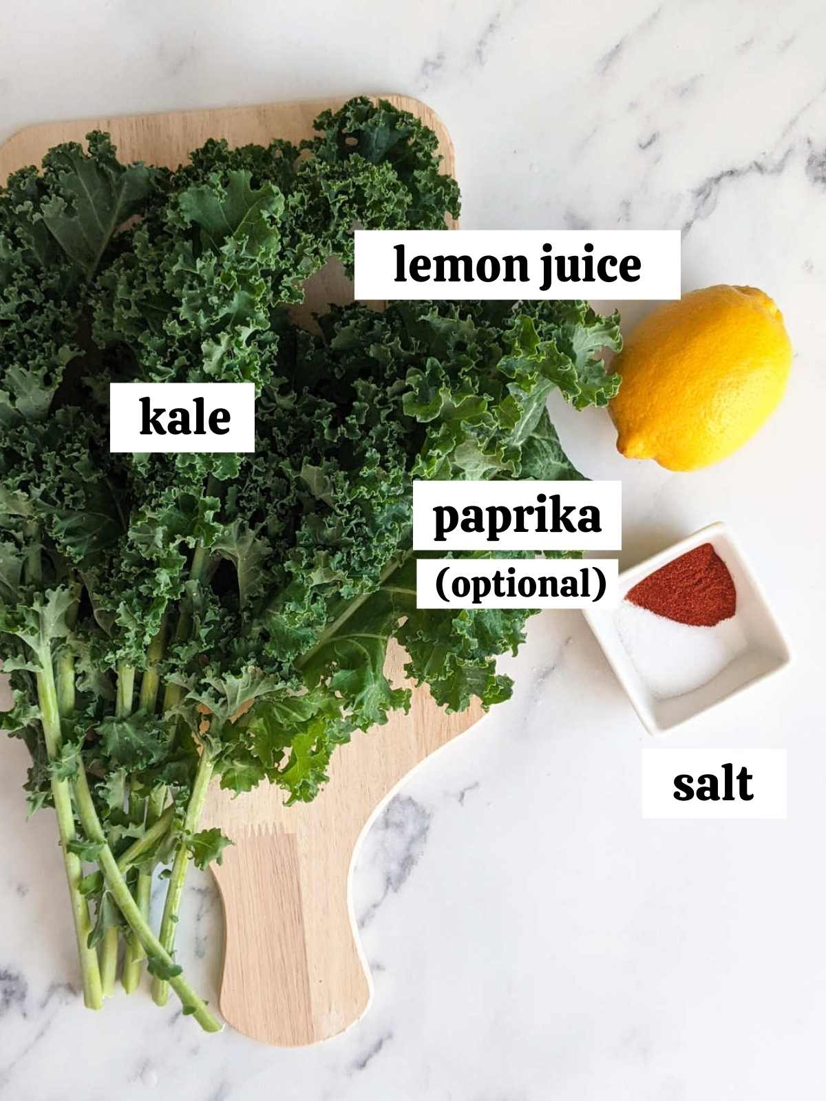 Ingredients for air fryer kale chips laid out and labelled.