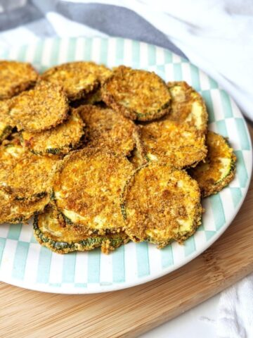 A plate of crispy baked zucchini chips