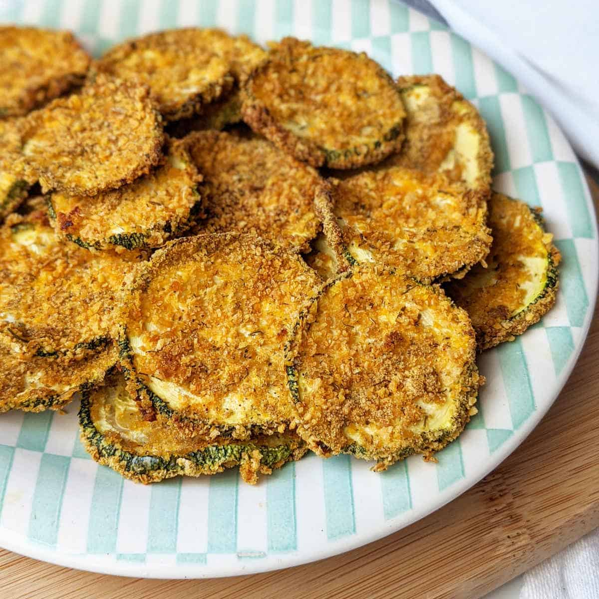 Zucchini chips on a plate.