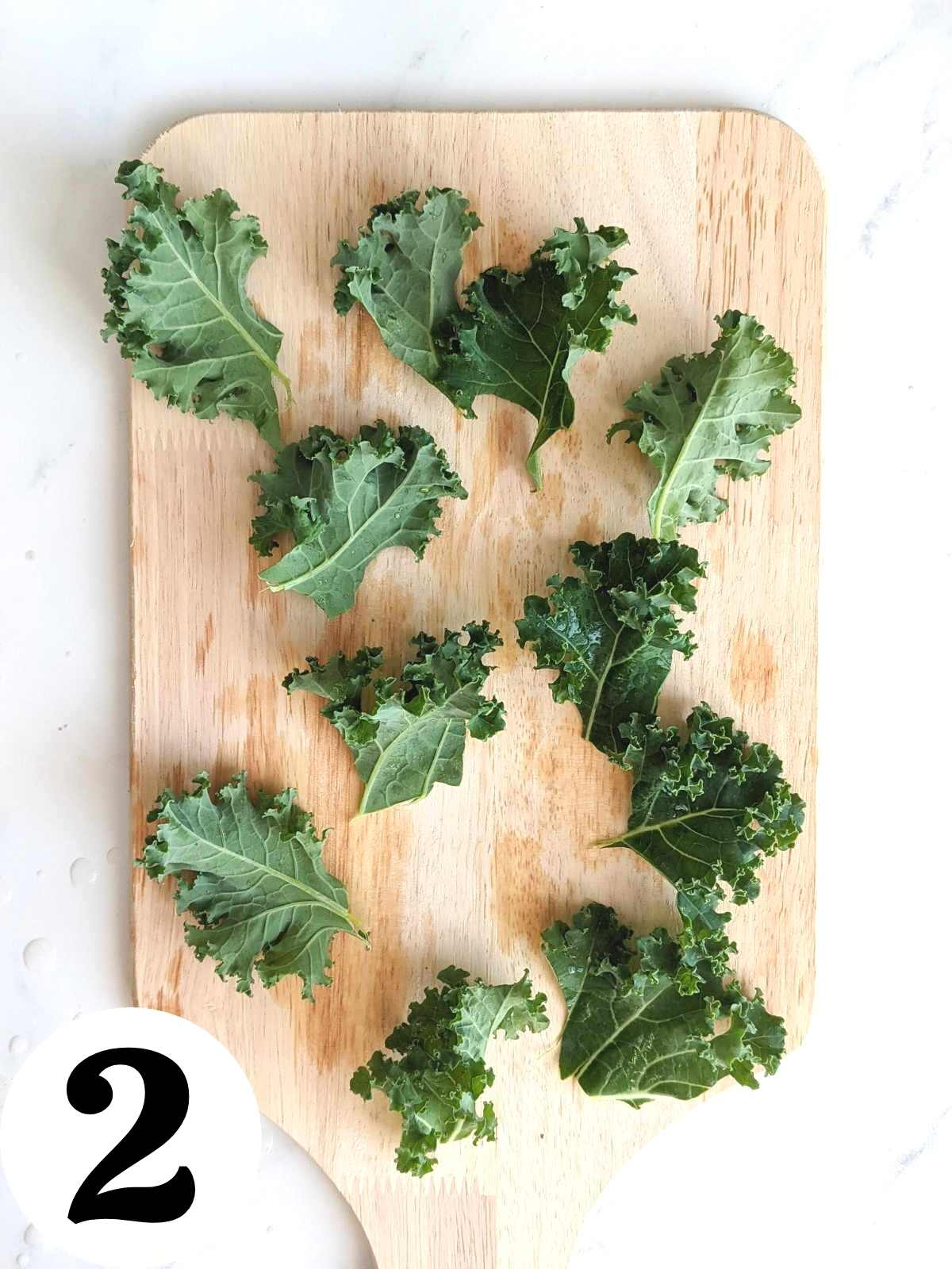 Chopped kale leaves on a cutting board.