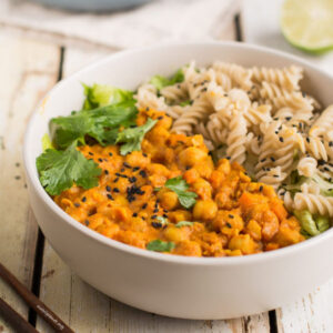 Bowl of chickpea curry with noodles