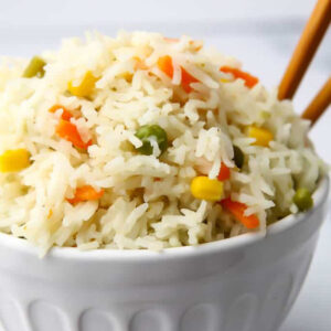 Thai coconut rice in a bowl with chopsticks