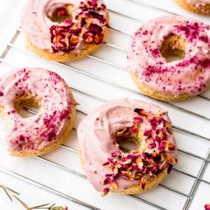 donuts on a rack topped with pink frosting