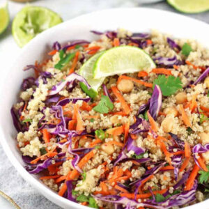 thai quinoa salad topped with a lime slice