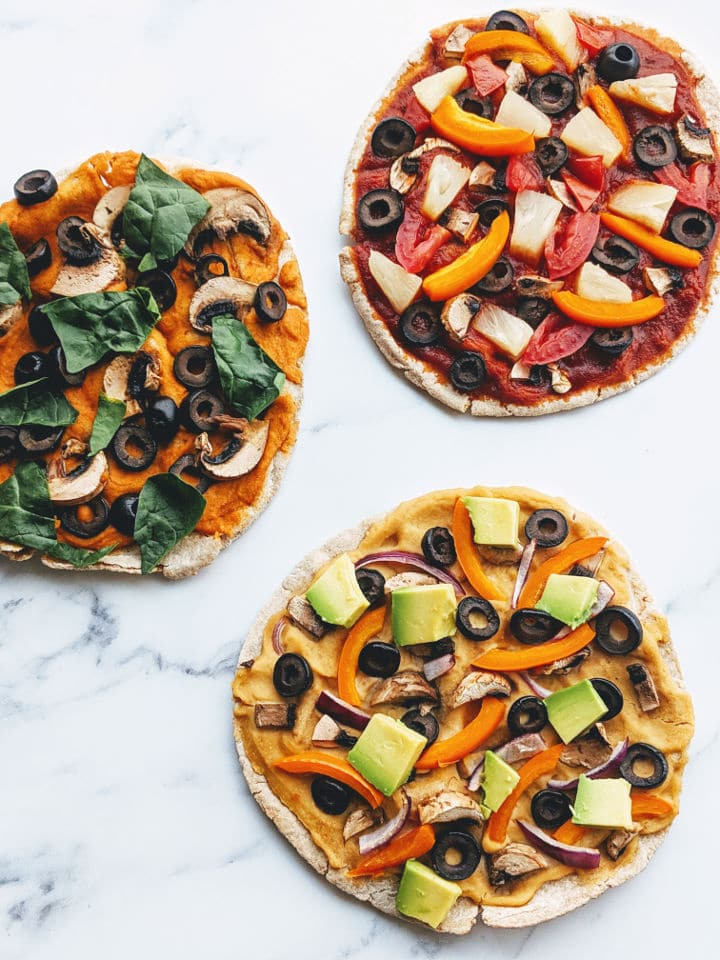 three pita pizzas with various toppings