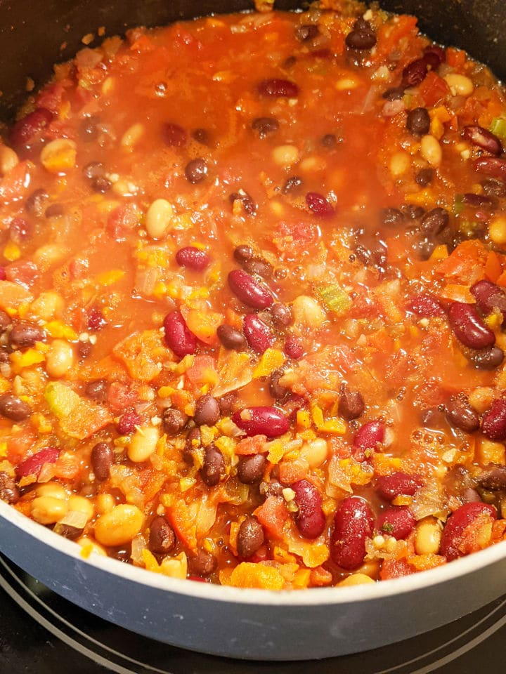 Cooking vegan bean chili on the stove