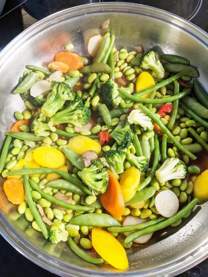 Stir fry vegetables in a pan
