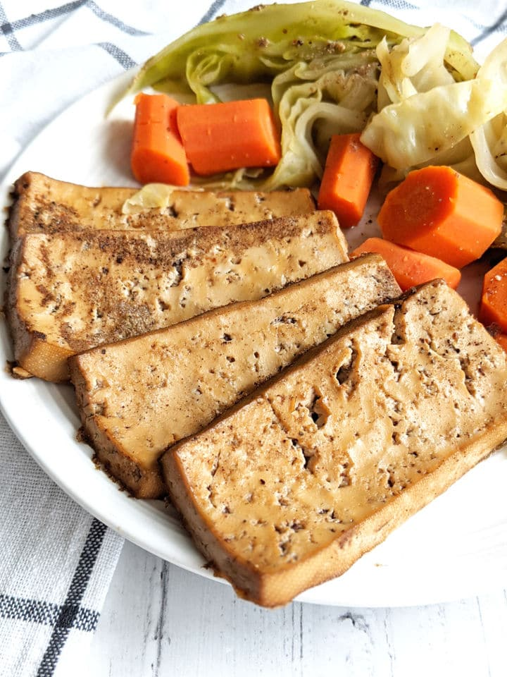 Tofu corned beef with cabbage and carrots on a plate