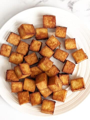 Cubed crispy baked tofu on a plate
