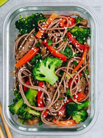 meal prepped noodle stir fry with veggies in a glass meal prep container