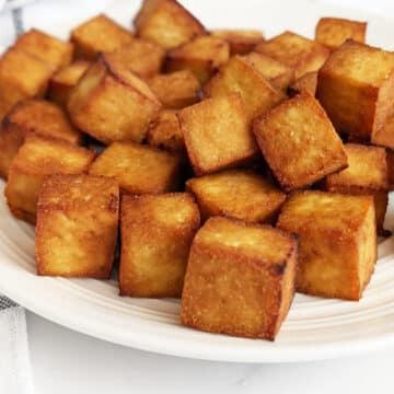 Crispy air fried tofu on a plate