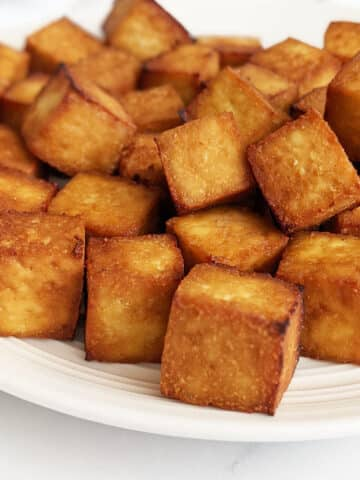 Crispy air fried tofu on a plate