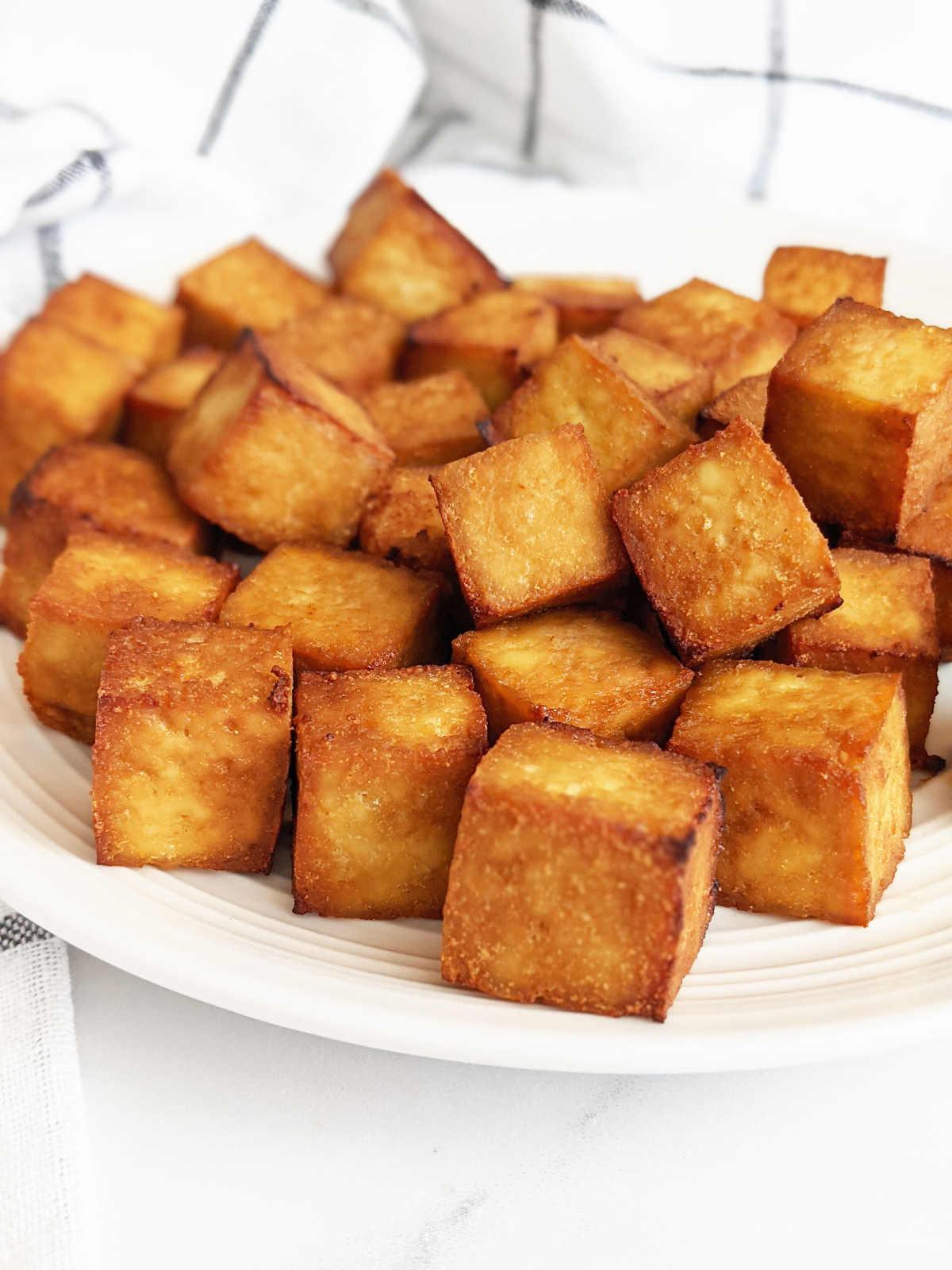 Crispy cubed tofu on a plate.