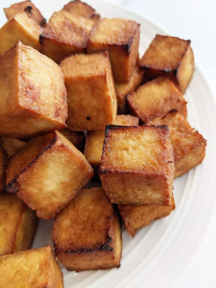 Up close image of crispy cube tofu on a plate
