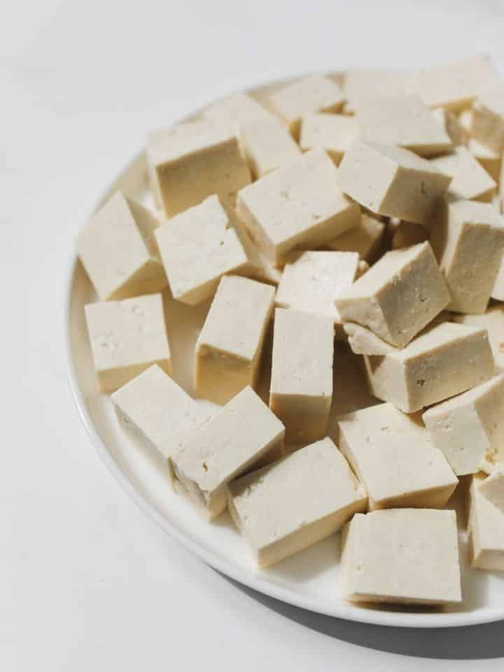 Cubes of soft tofu on a plate