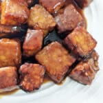 Up close of cooked tempeh smothered in sticky marinade