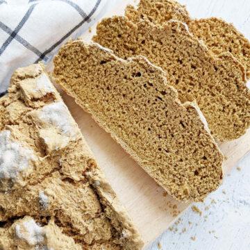 Vegan Irish Soda Bread sliced on a cutting board