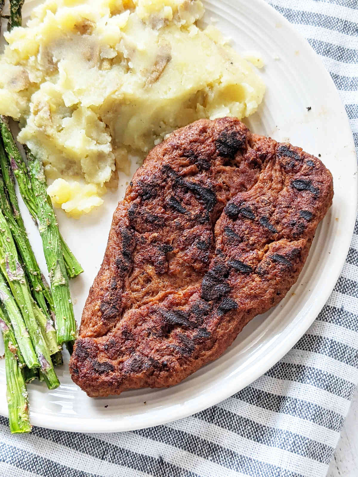 Vegan steak on a plate up close