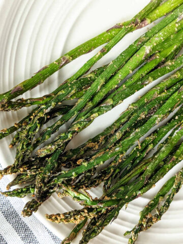 Roasted asparagus on a plate up close