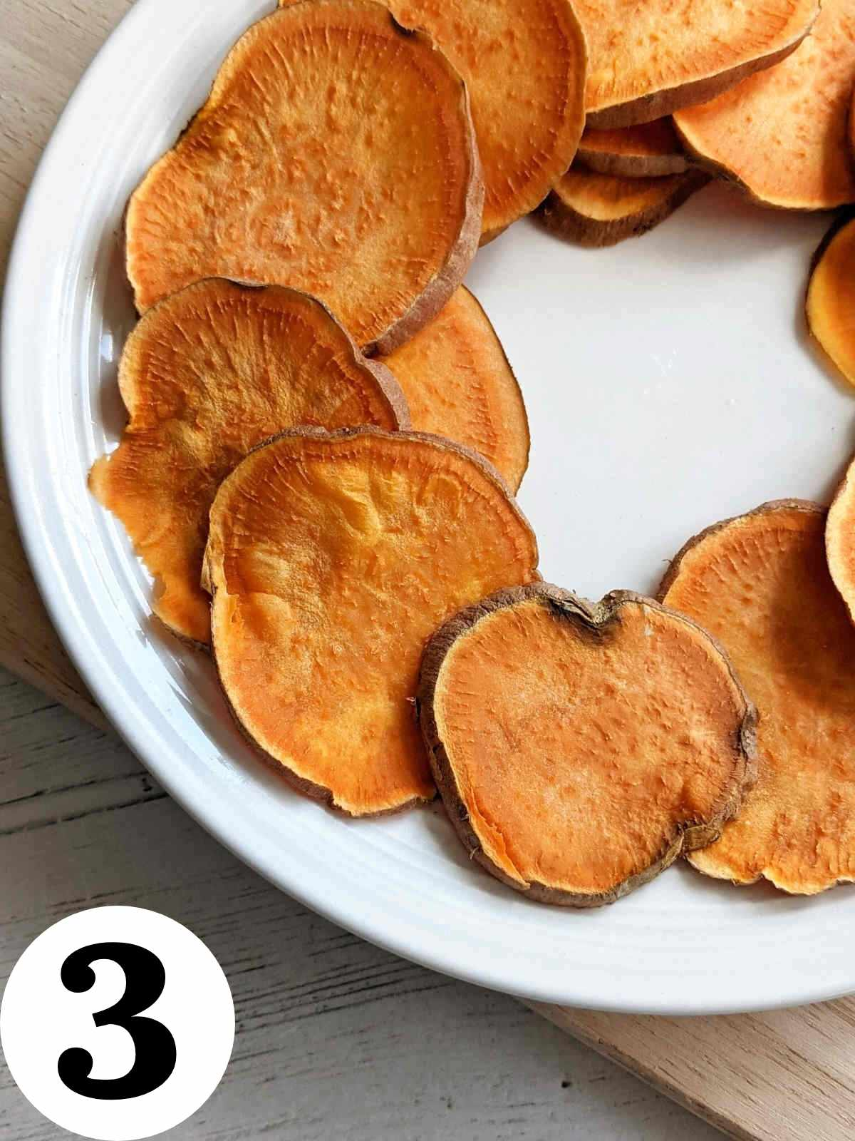 Cooked sliced sweet potato on a plate.