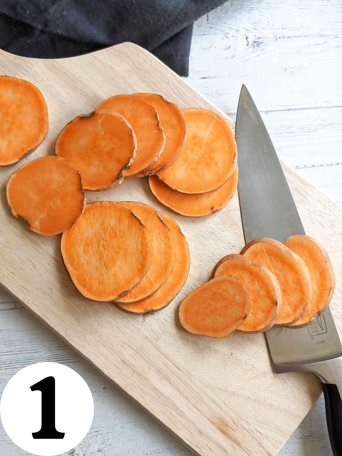 Sliced sweet potato on a cutting board.